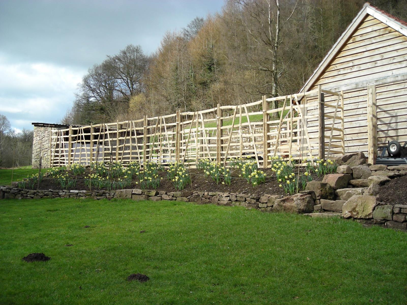 wooden boundary fences. Wooden fencing by Wiltshire fencer.